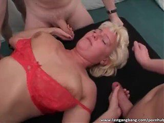 Mature slut enjoys hardcore group fucking