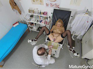 Sexy mature woman caught naked in the office of Freaky Doctor